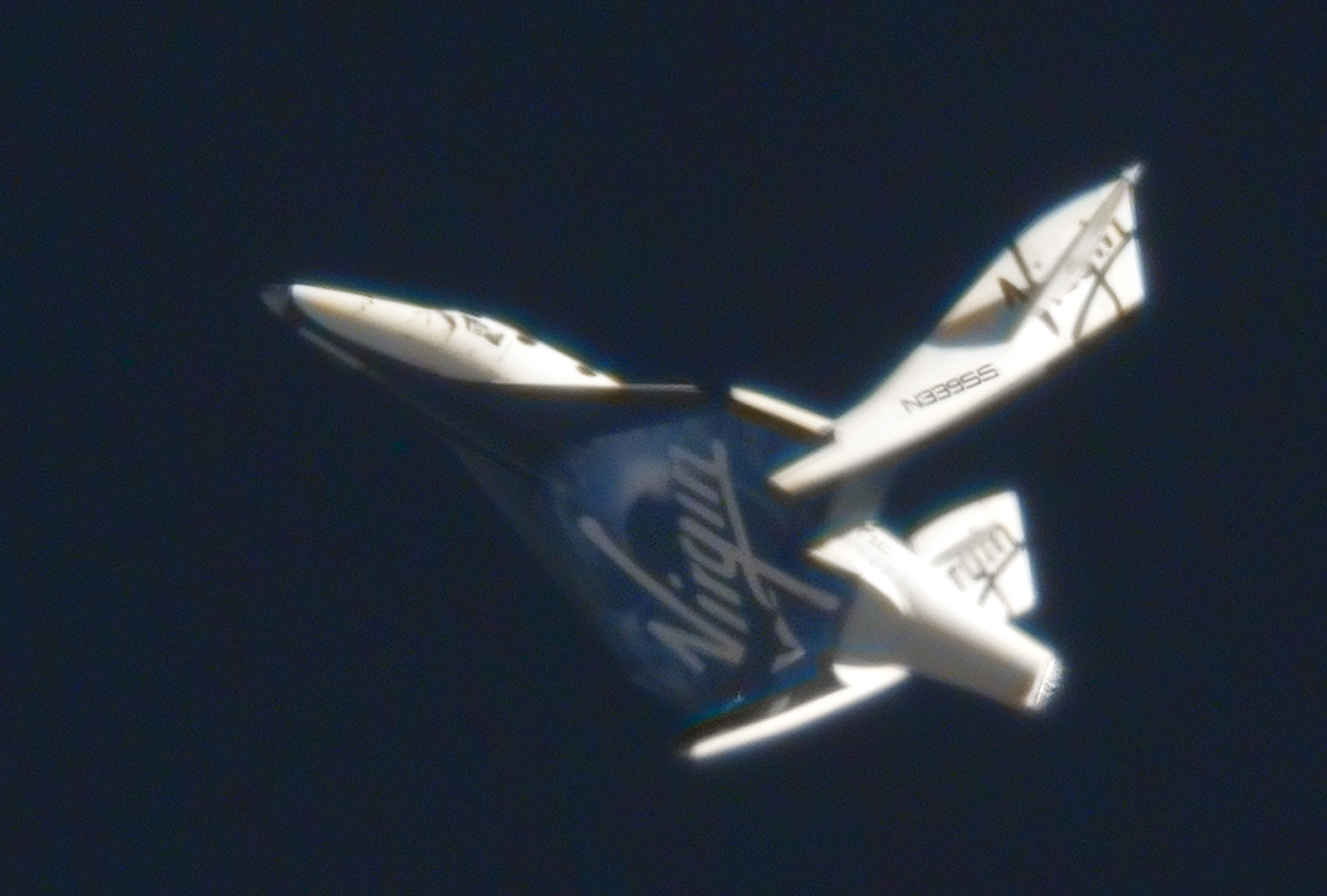 SpaceShipTwo's feathering system is seen deployed on a test flight in 2011. Credit: Clay Center Observatory/Virgin Galactic