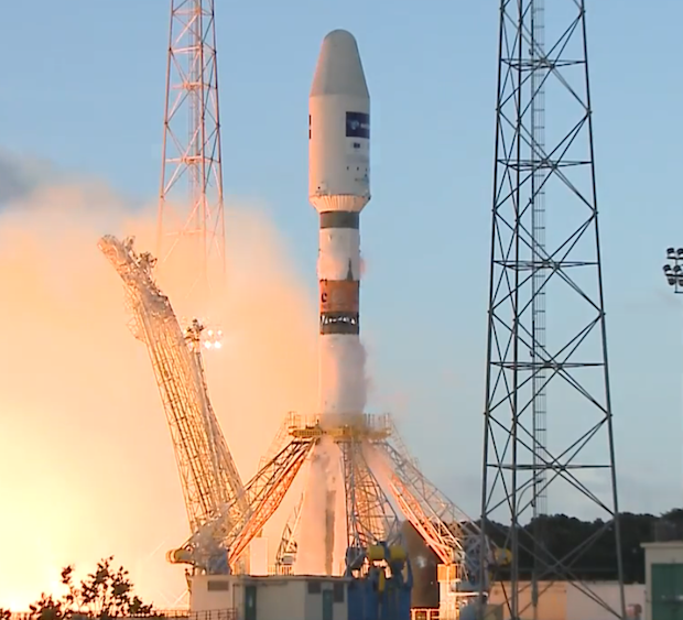 The five main engines of the Soyuz rocket's core stage and four strap-on boosters are at full thrust.