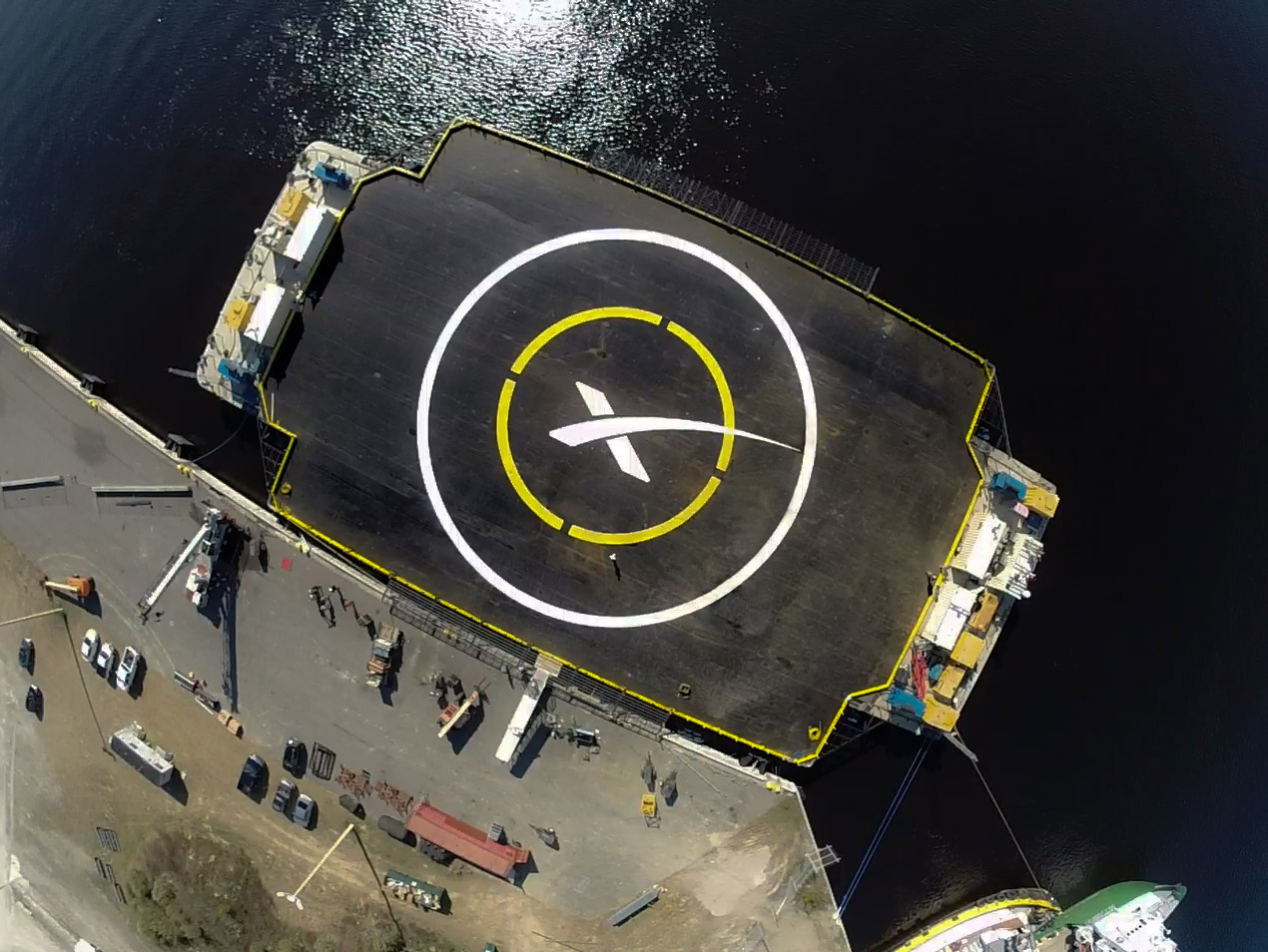 "An aerial view of SpaceX's rocket landing barge, named the Marmac 300 and unofficially christened the ""Autonomous Spaceport Drone Ship."" Credit: SpaceX"