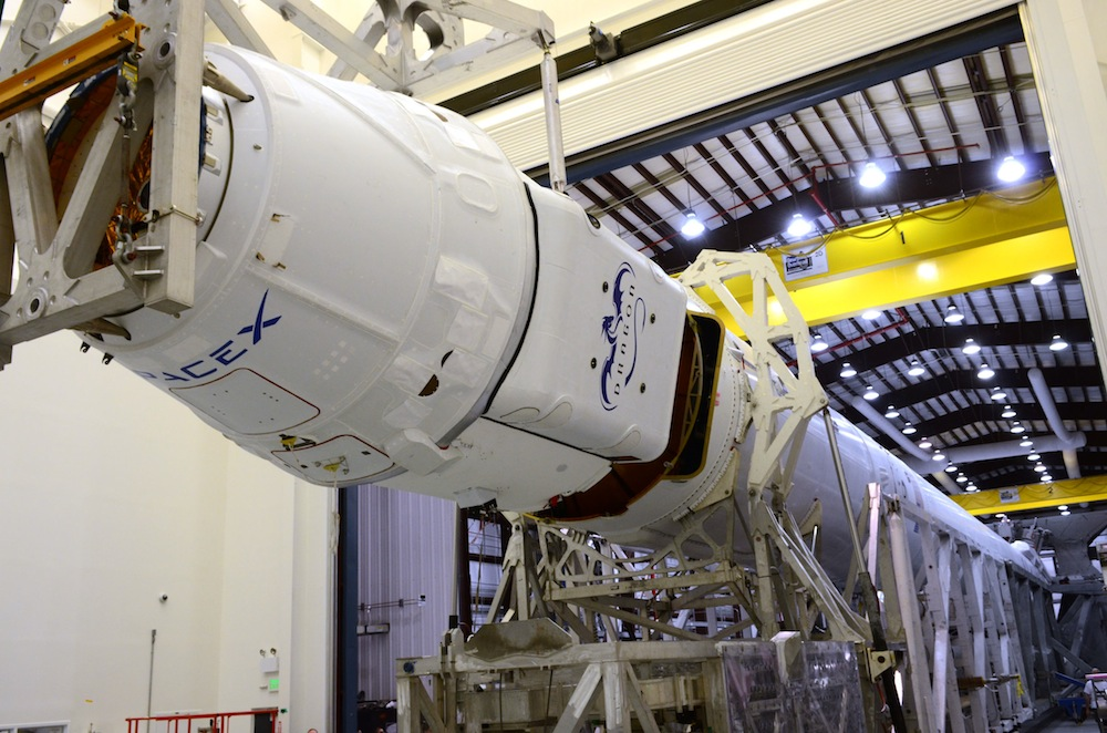 File photo of a Dragon spacecraft and Falcon 9 rocket prepared for a previous SpaceX resupply mission. Credit: SpaceX