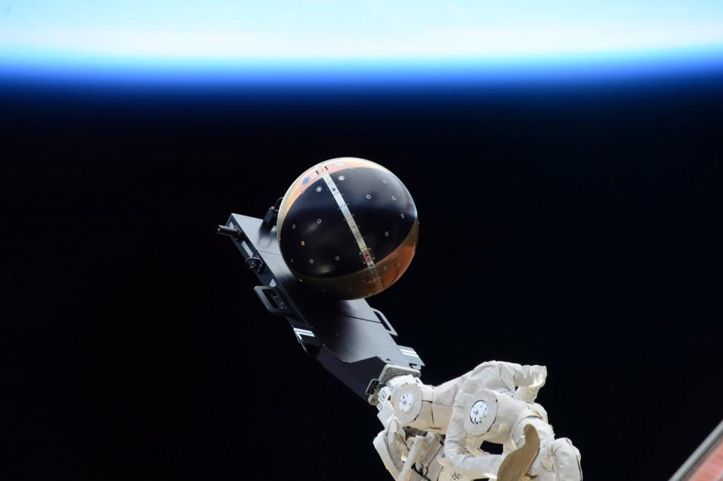 The SpinSat satellite before its release from the Cyclops deployer outside the International Space Station. Credit: NASA