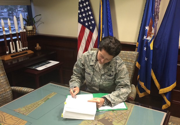 Brig. Gen. Nina Armagno, commander of the Air Force's 45th Space Wing, signs a five-year lease agreement for SpaceX to use Launch Complex 13 at Cape Canaveral Air Force Station as a landing pad. Credit: U.S. Air Force