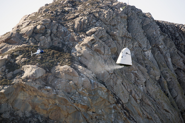 A mock-up of SpaceX's Crew Dragon spacecraft seen during parachute and recovery testing at Morro Bay, California. Credit: NASA/Kim Shiflett