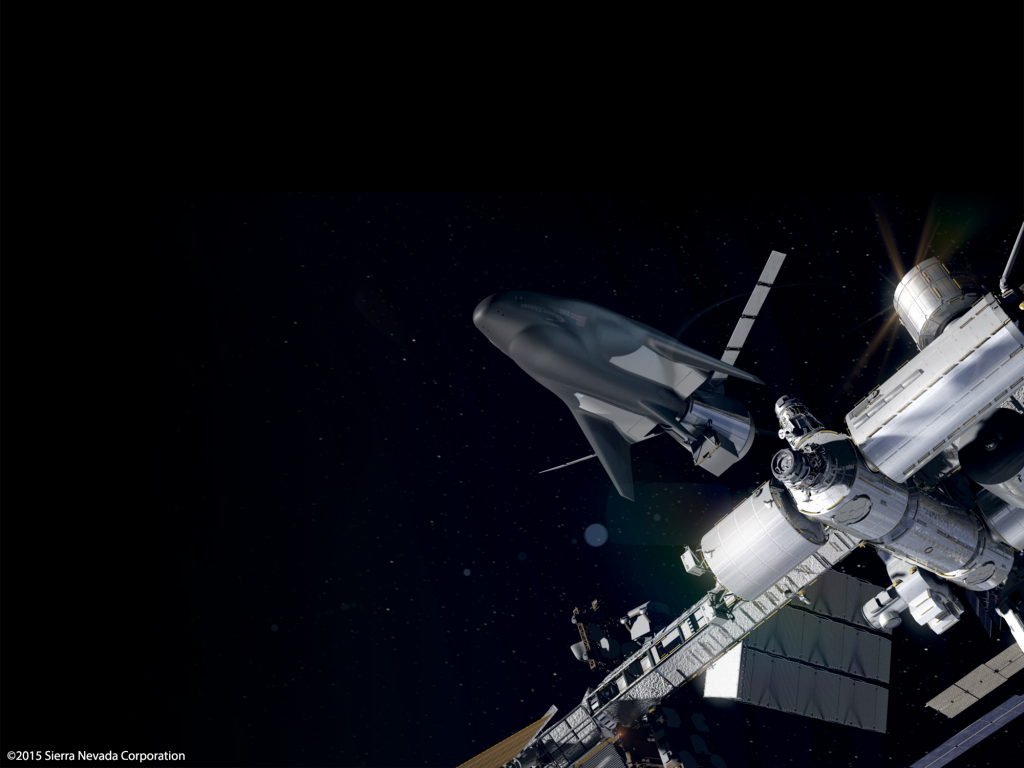 Artist's concept of the Dream Chaser cargo carrier at the International Space Station. Credit: Sierra Nevada Corp.