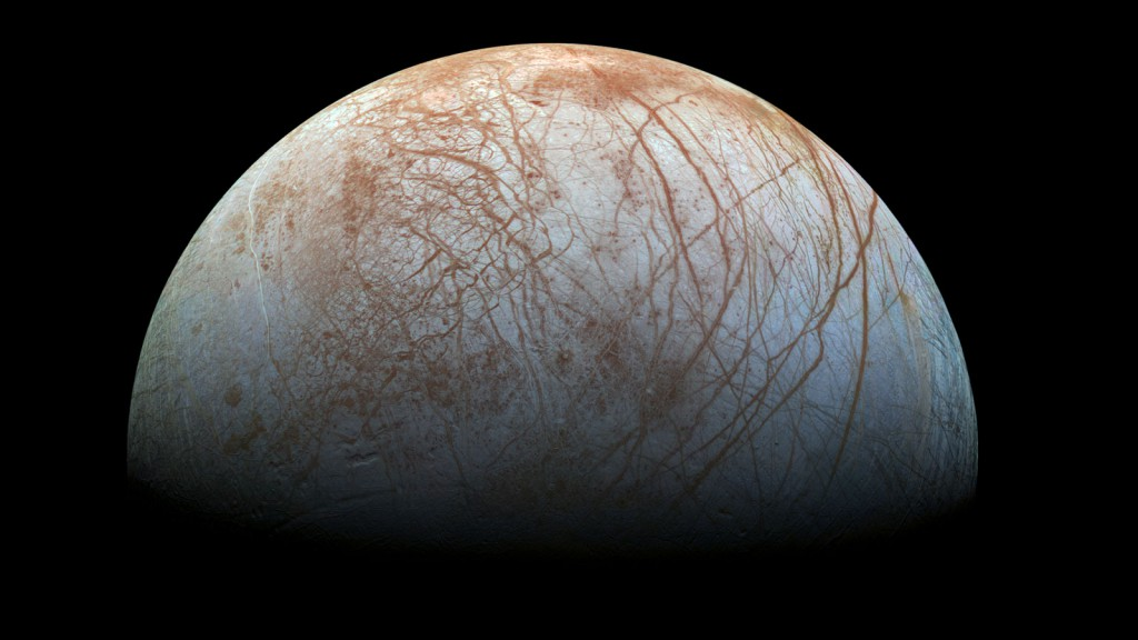 The puzzling, fascinating surface of Jupiter's icy moon Europa looms large in this newly-reprocessed color view, made from images taken by NASA's Galileo spacecraft in the late 1990s. Credit: NASA/JPL-Caltech/SETI Institute