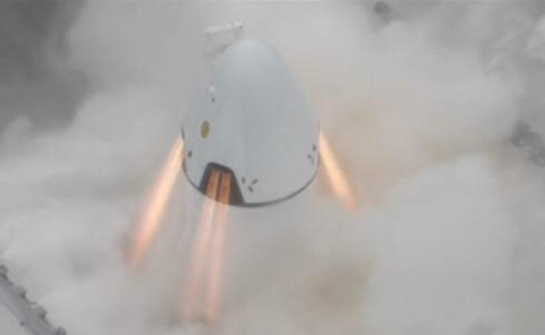 The prototype Dragon spacecraft fired its SuperDraco thrusters Tuesday for a preflight test. Credit: SpaceX