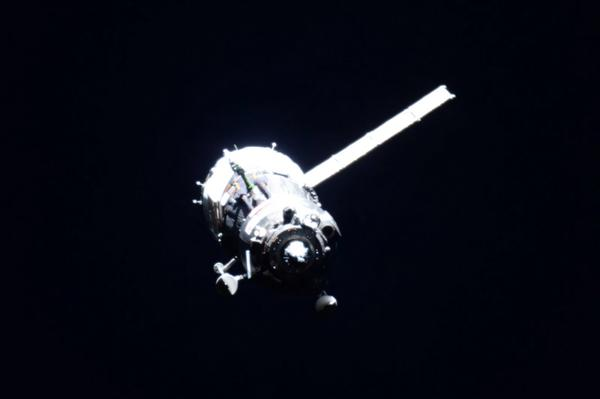 The Soyuz TMA-17M spacecraft approaches the International Space Station with only one solar array deployed. Credit: NASA/Scott Kelly
