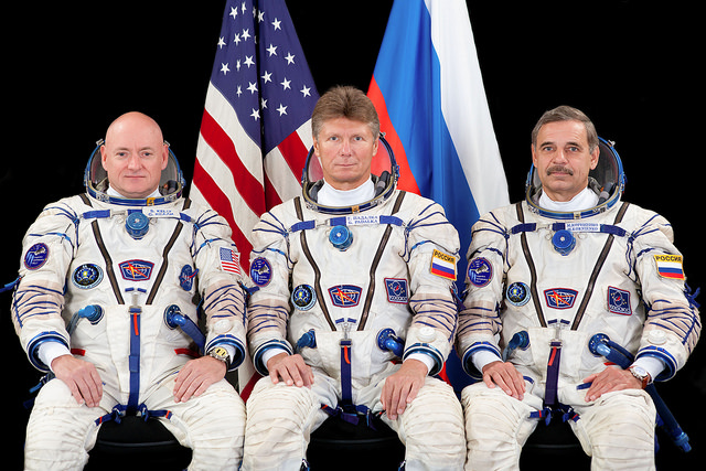 Scott Kelly, Gennady Padalka and Mikhail Kornienko (left to right) relocated the Soyuz TMA-16M spacecraft outside the International Space Station on Friday. Credit: NASA/GCTC