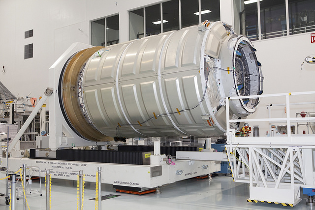 The pressurized cargo module for Orbital ATK's next supply mission, set for launch on an Atlas 5 on Dec. 3. Credit: NASA/Dmitri Gerondidakis