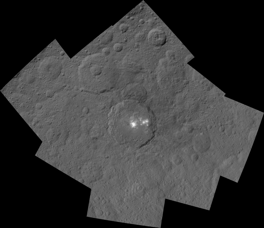This mosaic shows Ceres' Occator crater and surrounding terrain from an altitude of 915 miles (1,470 kilometers), as seen by NASA's Dawn spacecraft. Occator is about 60 miles (90 kilometers) across and 2 miles (4 kilometers) deep. Occator is home to the brightest area on Ceres, which tends to appear overexposed in most images. This view uses a composite of two images of Occator: one using a short exposure that captures the detail in the bright spots, and one where the background surface is captured at normal exposure. Credit: NASA/JPL-Caltech/UCLA/MPS/DLR/IDA