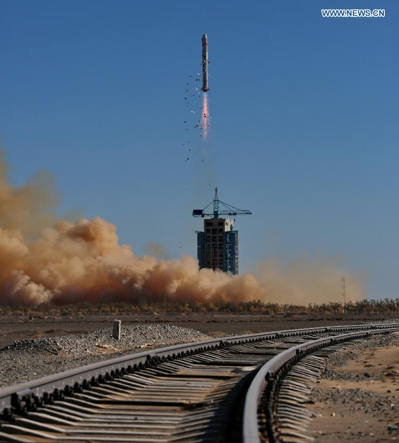 A Long March 2D rocket blasts off from the Jiuquan launch center Monday with the Tianhui 1C mapping satellite. Thermal insulation panels are seen shedding from the rocket, a normal feature of a Long March 2D launch. Credit: Xinhua