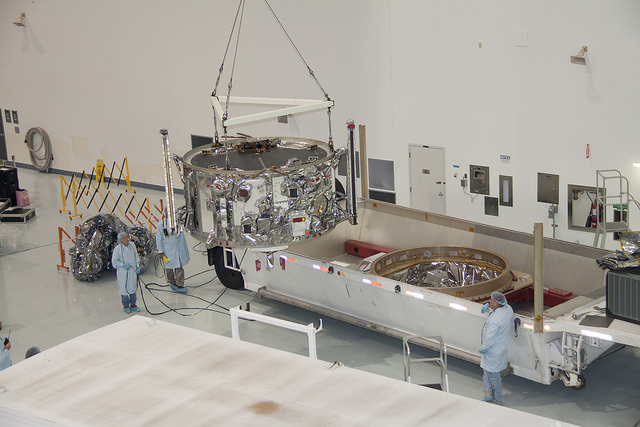 The Cygnus spacecraft's service module is removed from its shipping container in this Oct. 15 image after its arrival at the Kennedy Space Center's Space Station Processing Facility from Orbital ATK's factory in Dulles, Virginia. Credit: NASA/Jim Grossmann