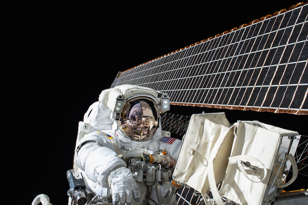 Astronaut Scott Kelly is seen working outside the space station in this picture from the Nov. 6 spacewalk. One of the outpost's giant solar array wings is in the background. Credit: NASA