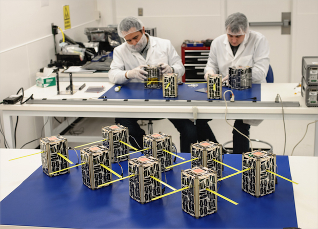 Engineers work with flight unit and spare CubeSats for NASA's EDSN mission. Credit: NASA/Ames