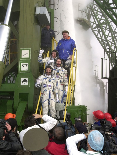 """""""Get those shuttles ready!"""" yelled Shepherd moments before boarding Expedition 1's Soyuz spacecraft at Baikonur, alluding to the arduous in-orbit assembly task ahead involving dozens of space shuttle flights. Credit: NASA"""