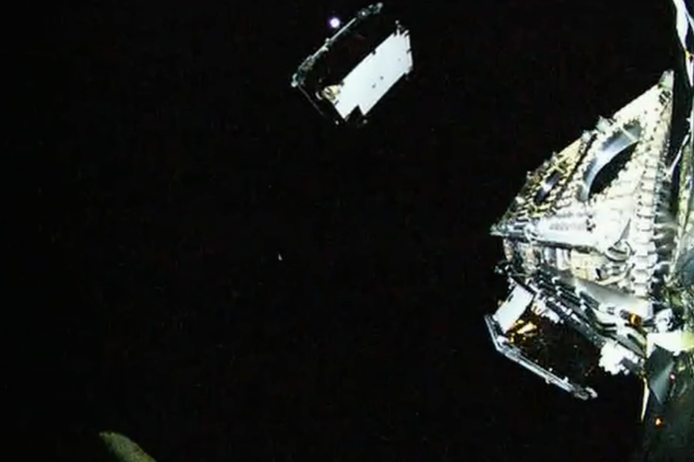 """One of the 11 Orbcomm communications satellites launched Monday separates from the Falcon 9's second stage in this view from an on-board """"rocketcam"""" broadcast by SpaceX. Credit: SpaceX"""