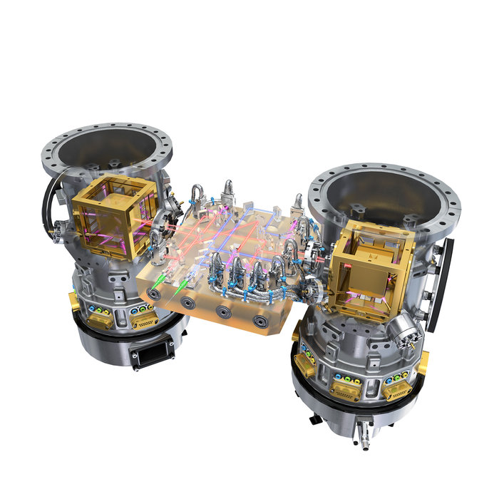 The two gold cubes, enclosed in vacuum containers (shown here without the launch lock mechanism), are key to the LISA Pathfinder mission. Each of these electrode containers houses a gold-platinum test mass. LISA Pathfinder will monitor the two cubes as they enter free-fall motion using a high-precision laser interferometer. Credit: ESA