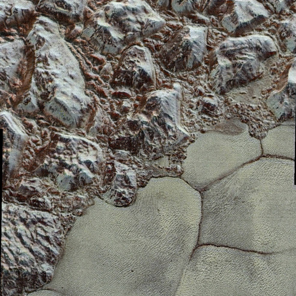 This image of the boundary of Sputnik Planum and neighboring mountains is seen in exaggerated color to distinguish compositional differences. Credit: NASA/Johns Hopkins University Applied Physics Laboratory/Southwest Research Institute