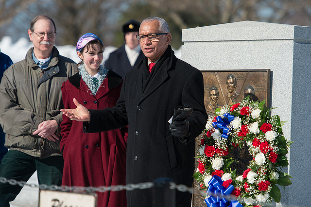 NASA Administrator Charles Bolden (right) stands next to Challenger astronaut Judith Resnik's brother, Chuck Resnik, left, and his daughter, Jenna Resnik, center, as he speaks to NASA personnel and others during a wreath laying ceremony at Arlington National Cemetery as part of NASA's Day of Remembrance on the 30th anniversary of the Challenger accident. Credit: NASA/Aubrey Gemignani