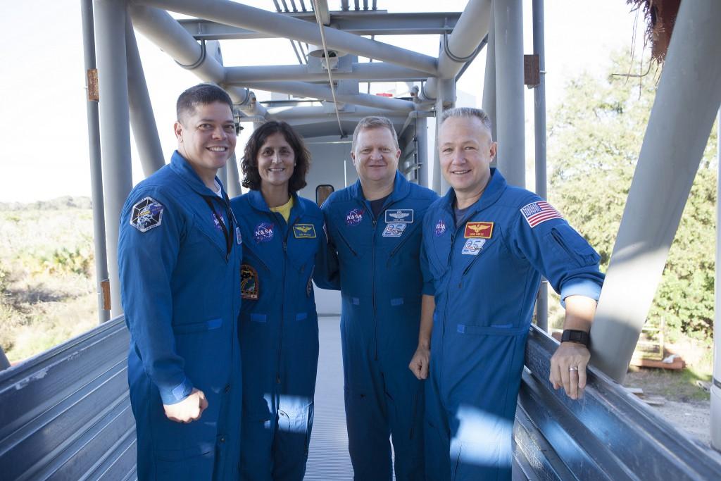 Behnken, Williams, Boe and Hurley survey the Atlas crew access arm. Credit: NASA