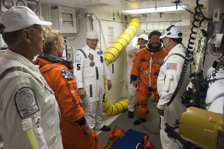 File photo of the final shuttle crew boarding Atlantis. Credit: NASA