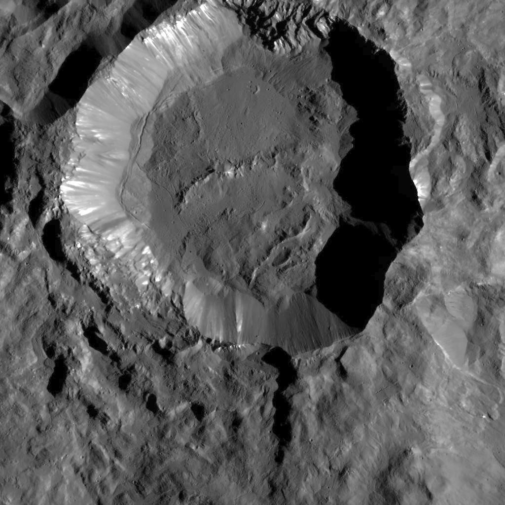 This image from NASA's Dawn spacecraft shows Kupalo Crater, one of the youngest craters on Ceres. The crater has bright material exposed on its rim and walls, which could be salts. Its flat floor likely formed from impact melt and debris. Kupalo, which measures 16 miles (26 kilometers) across and is located at southern mid-latitudes, is named for the Slavic god of vegetation and harvest. Credit: NASA/JPL-Caltech/UCLA/MPS/DLR/IDA