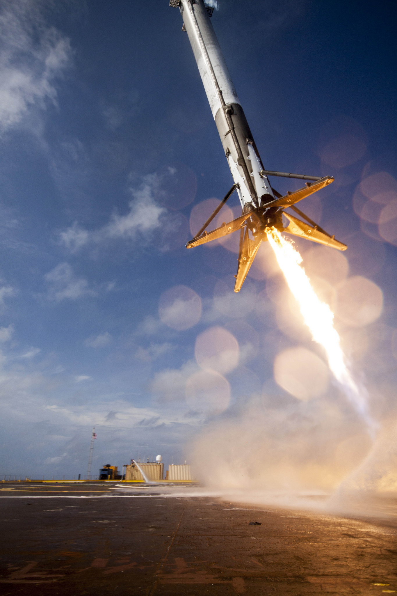 File photo of a Falcon 9 first stage descending to landing ship in the Atlantic Ocean after launching from Cape Canaveral on April 14, 2015. The rocket tipped over after touchdown and exploded in a fireball after a stuck throttle valve caused the rocket to lose control. Credit: SpaceX