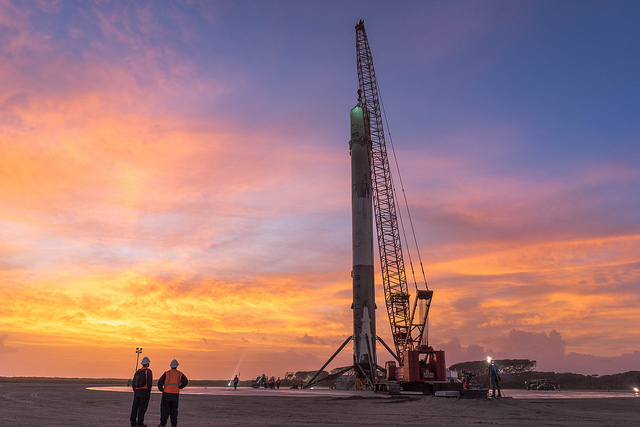The first stage of SpaceX's Falcon 9 rocket is pictured after landing at Cape Canaveral following a Dec. 21 launch with 11 satellites. Credit: SpaceX