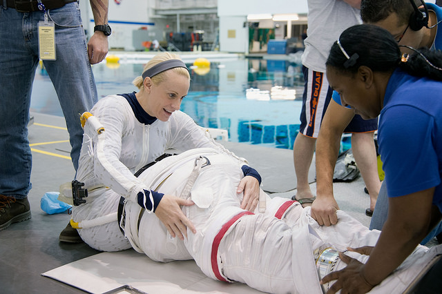Astronaut Kate Rubins is seen during spacewalk training at the Neutral Buoyancy Laboratory in Houston. Rubin is set to fly to the space station in May. Credit: NASA/James Blair