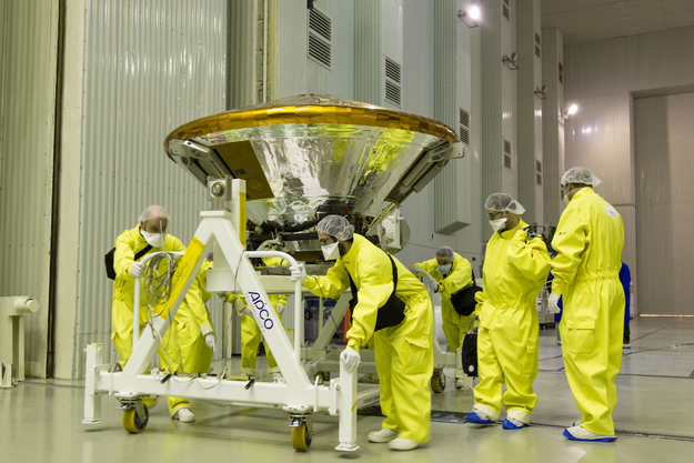 Schiaparelli's ground team moves the landing module for attachment to the ExoMars Trace Gas Orbiter. Credit: ESA - B. Bethge