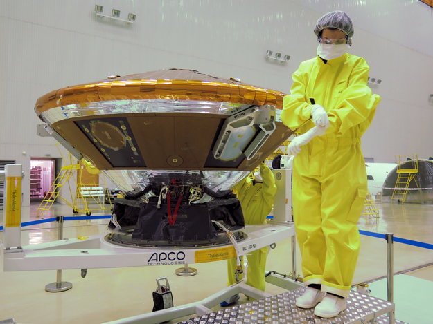 A technician working near the Schiaparelli lander wears a protective suit after fueling of the spacecraft with hazardous hydrazine fuel. Credit: Thales Alenia Space