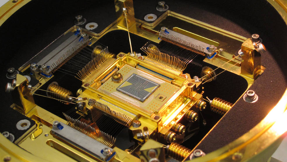 The heart of the ASTRO-H Soft X-ray Spectrometer is the microcalorimeter array at center. The five-millimeter square forms a 36-pixel array. Each pixel is 0.824 millimeter on a side, or about the width of the ball in a ballpoint pen. The detector's field of view is approximately three arcminutes, or one-tenth the apparent diameter of the full moon. Credits: NASA's Goddard Space Flight Center