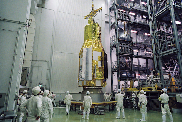 Ground crews prepare the Astro-H spacecraft for launch at the Tanegashima Space Center in Japan. Credit: JAXA