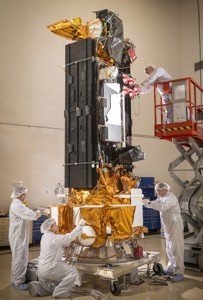 Engineers work on the DMSP F19 satellite during final launch preparations at Vandenberg Air Force Base, California. Credit: Lockheed Martin