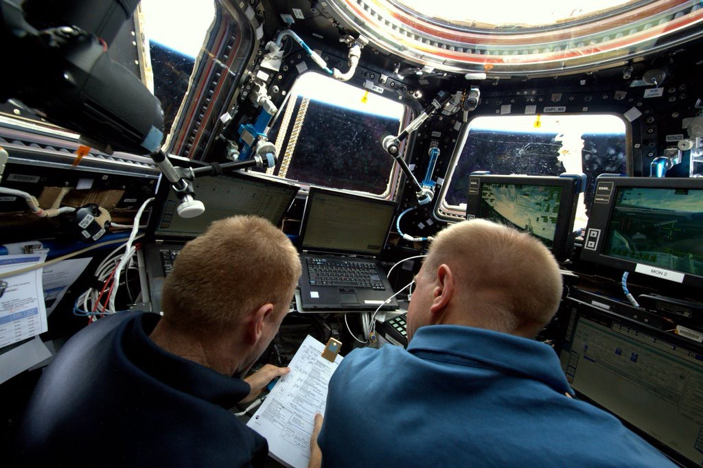 Peake, (left) and Kopra (right) work in tandem in the Cupola. Credit: Astronaut Tim Peake