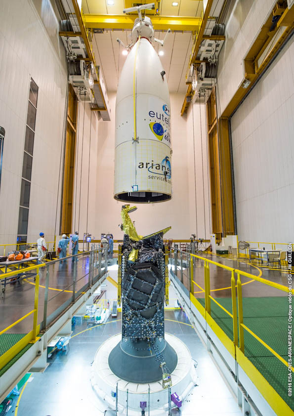 The Eutelsat 65 West A is encapsulated inside the Ariane 5 rocket's payload fairing in the final assembly building. Credit: Credit: ESA/CNES/Arianespace – Photo Optique Video du CSG - JM Guillon