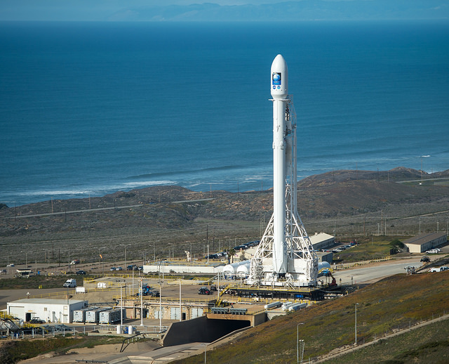 File photo of a SpaceX Falcon 9 rocket on the launch pad at Vandenberg Air Force Base, California. Credit: NASA/Bill Ingalls