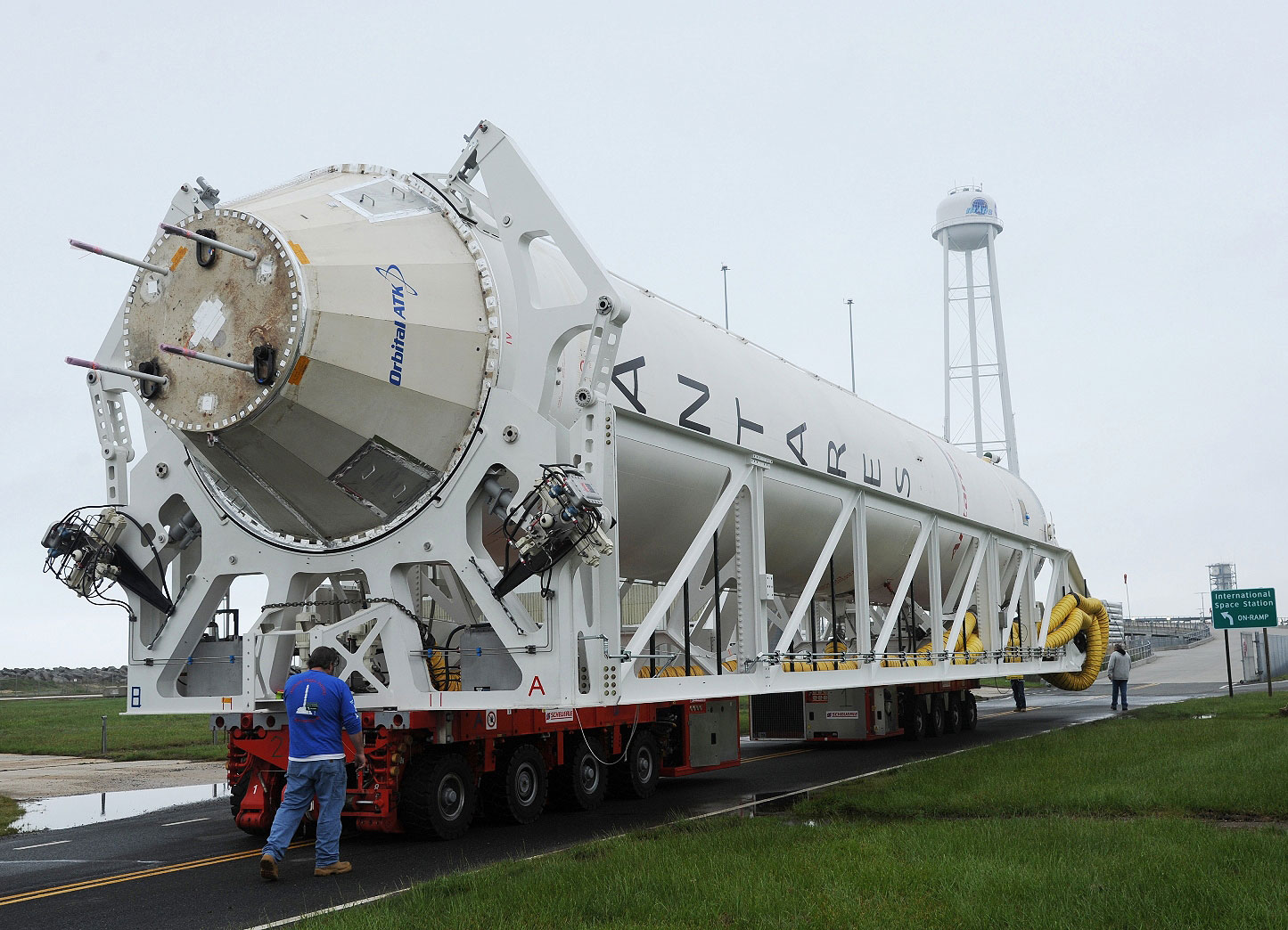 An Antares first stage booster rolls out to pad 0A at the Mid-Atlantic Regional Spaceport at Wallops, Island, Virginia, on Thursday. Credit: Orbital ATK