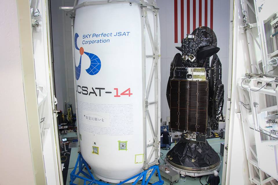 The JCSAT 14 satellite is pictured before encapsulation inside the Falcon 9's payload fairing. Credit: SpaceX