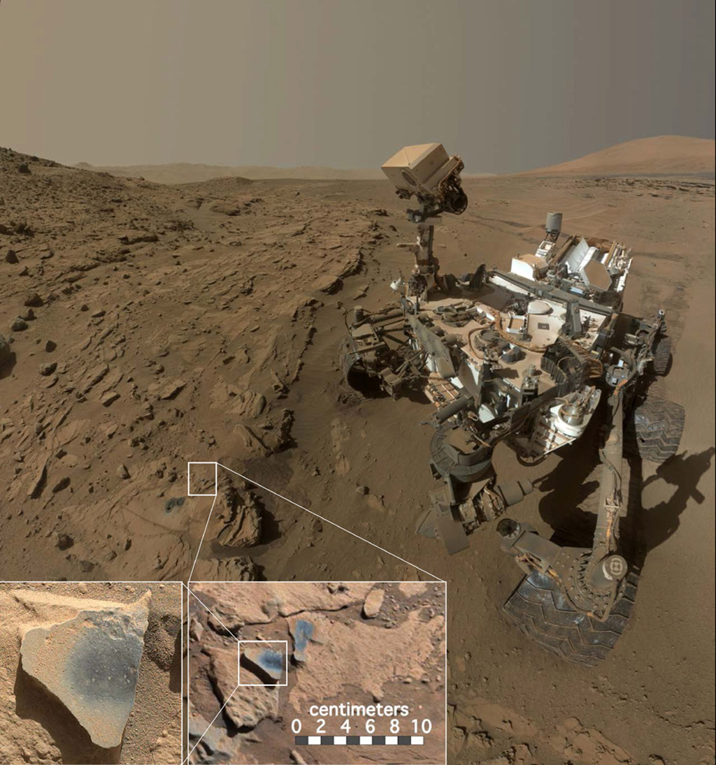 """This scene shows NASA's Curiosity Mars rover at a location called """"Windjana,"""" where the rover found rocks containing manganese-oxide minerals, which require abundant water and strongly oxidizing conditions to form. Credit: NASA/JPL-Caltech/MSSS"""