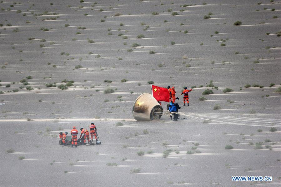 The re-entry module landed Sunday measures about 7.5 feet (2.3 meters) tall, 8.5 feet (2.6 meters) in diameter, and weighs about 5,730 pounds (2,600 kilograms). It is about half the size of China's planned replacement for the Shenzhou crew capsule. Credit: Xinhua