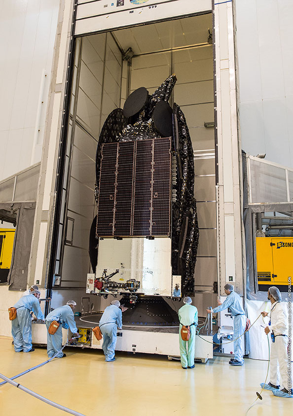 The EchoStar 18 satellite is seen during launch preparations in French Guiana. ESA/CNES/Arianespace – Photo Optique Video du CSG – JM Guillon