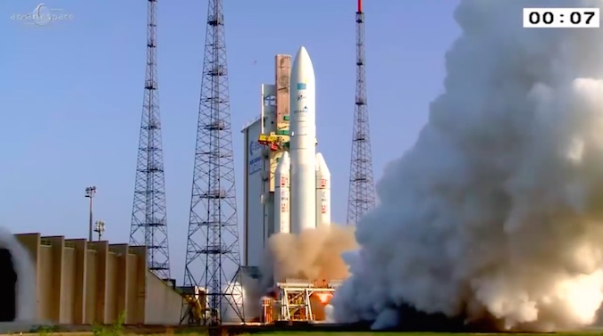 The Ariane 5's two solid rocket boosters ignite seven seconds later, each generating more than 1.3 million pounds of thrust.