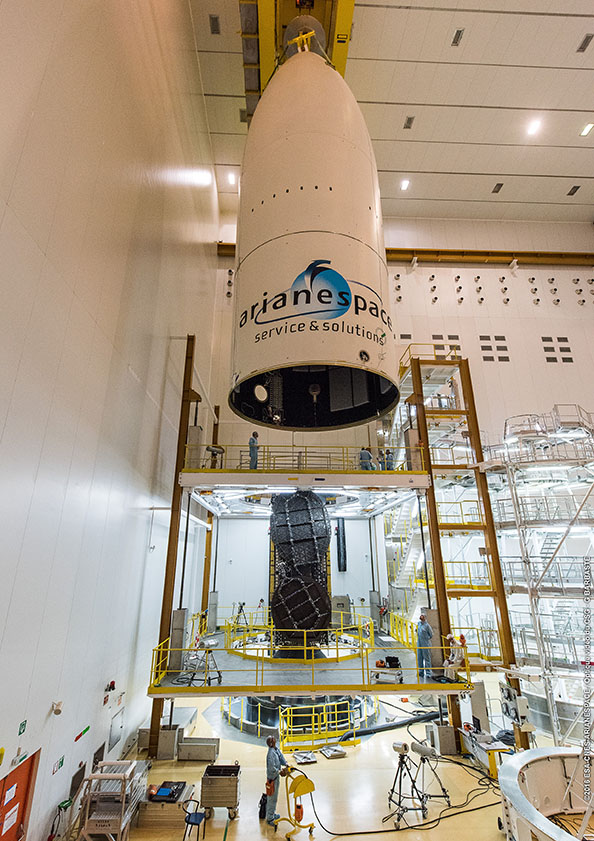 The Ariane 5's payload fairing was lowered over the EchoStar 18 satellite and the Sylda adapter system May 14. Credit: ESA/CNES/Arianespace – Photo Optique Video du CSG – G. Barbaste