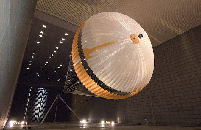 In this photo from a 2009 wind tunnel test, a parachute for NASA's Curiosity rover mission undergoes a preflight check. Credit: NASA