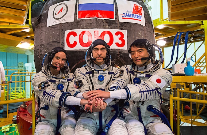 NASA astronaut Kate Rubins, Russian Soyuz commander Anatoly Ivanishin, and Japanese flight engineer Takuya Onishi will launch 0136 GMT Thursday (9:36 p.m. EDT Wednesday). The crew poses here with the Soyuz MS-01 spacecraft during final preparations before launch. Credit: GCTC