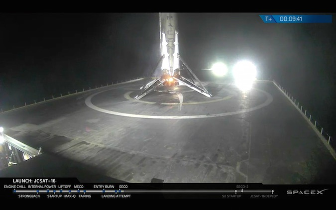 The Falcon 9's first stage booster, a vehicle 156 feet tall and 12 feet in diameter, settled to a bullseye landing on SpaceX's drone ship in the Atlantic Ocean. Credit: SpaceX