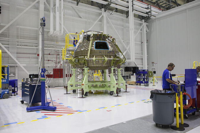 The pressure hull for Boeing's CST-100 Starliner structural test article sits inside a repurposed space shuttle hangar at NASA's Kennedy Space Center in Florida in this July 25 photo. Credit: NASA/Kim Shiflett