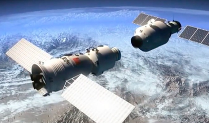 Artist's concept of the Shenzhou 11 (left) and Tiangong 2 (right) spacecraft docking in orbit. Credit: CCTV