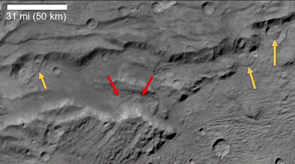 Scientists from NASA's New Horizons mission have spotted signs of long run-out landslides on Pluto's largest moon, Charon. Credit: NASA/JHUAPL/SWRI